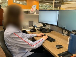Example of a chair being too low at the desk