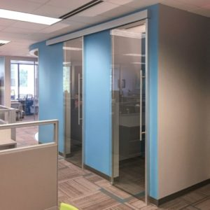 Colorful panels and modular glass walls for San Diego offices